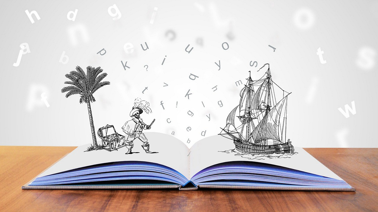 An Open Book with a story about tropical pirates, a treasure chest and pirate ships coming off the page.
