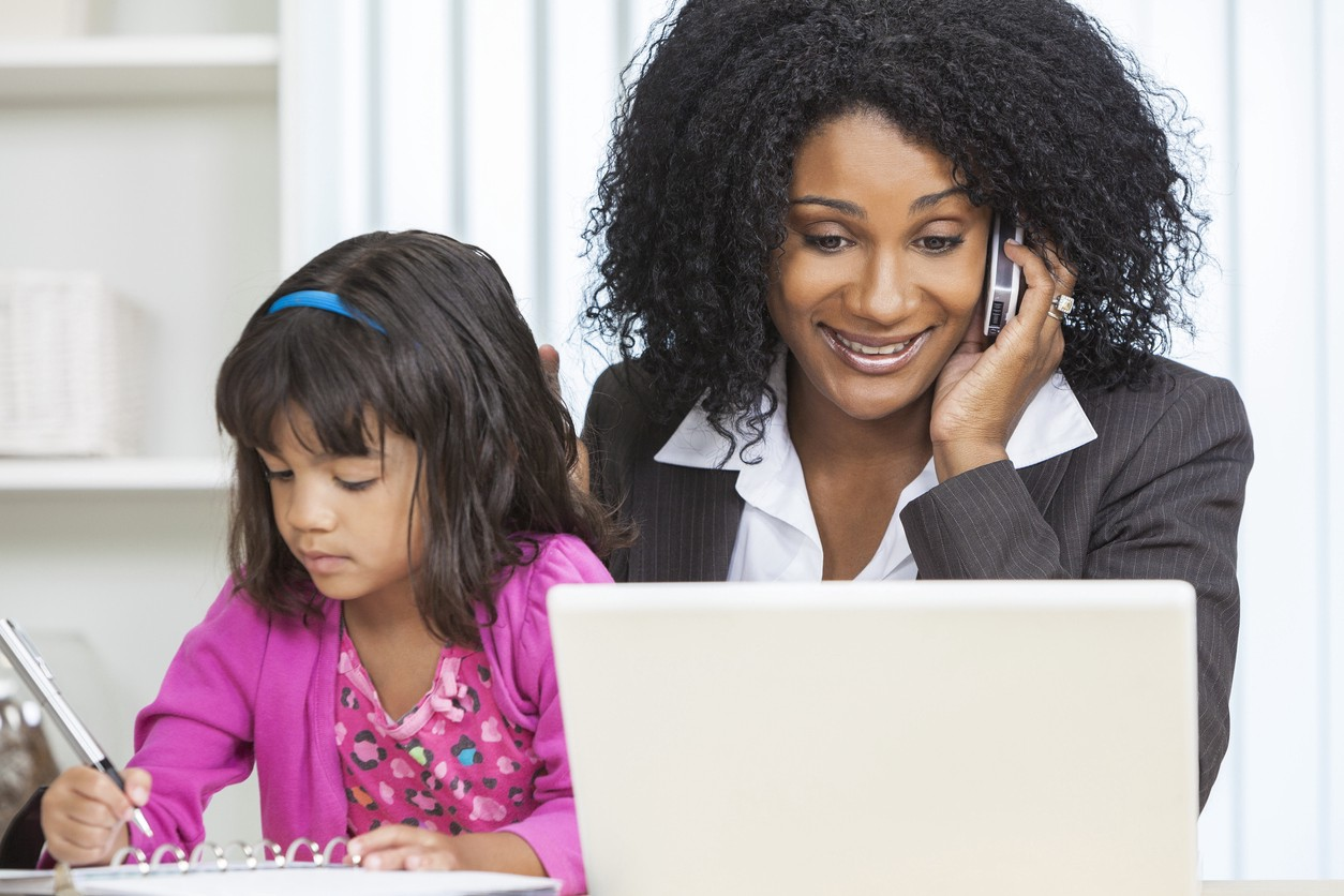 African American woman on phone—working mother