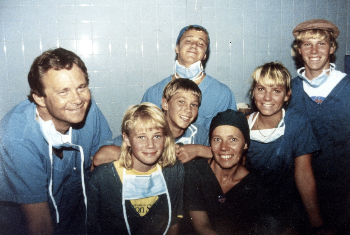 Bill and Kathy Magee pose in scrubs with their five children during a medical mission.