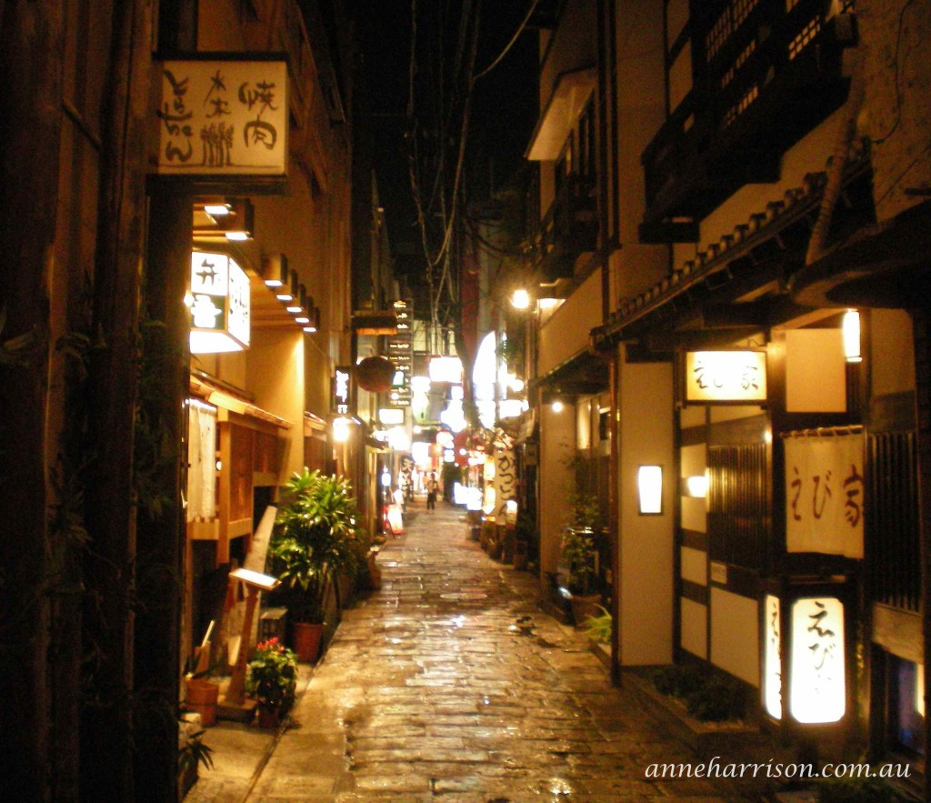 A cobbled lane of restaurants in Japan