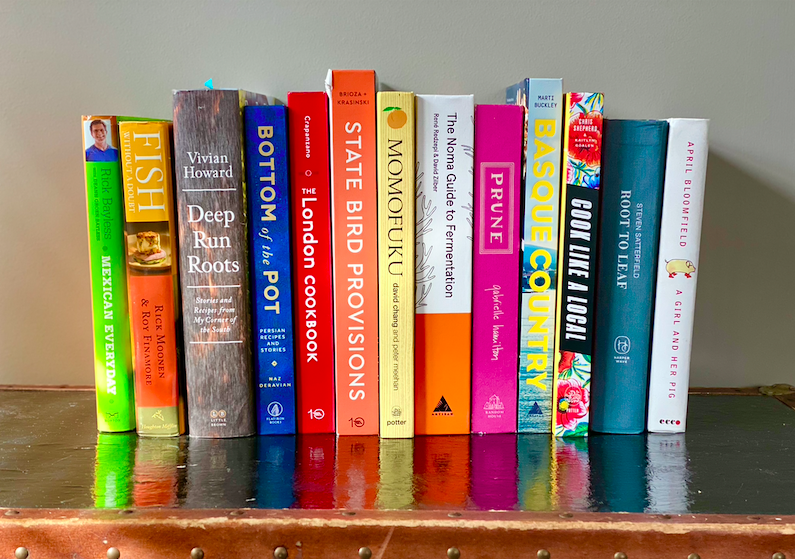 cookbooks on shelf illustrating use of cookbook search engine eat your books