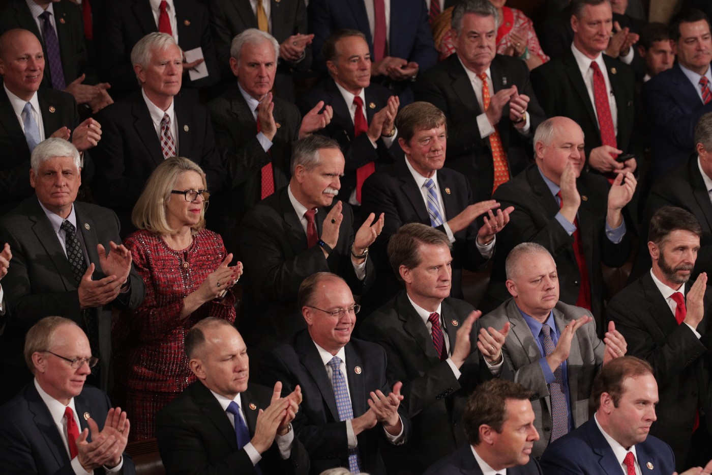 Lawmakers watch the State of the Union address in the chamber of the U.S. House of Representatives at the Capitol Building