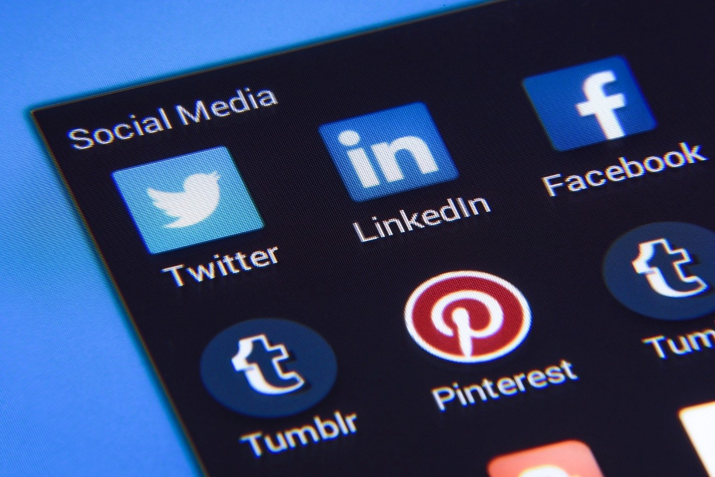 Phone screen showing icons for social media sites such as Twitter, LinkedIn, Facebook, Tumblr, and Pinterest.