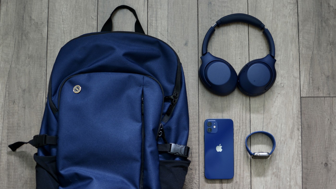 All my new blue things: blue backpack, headphones, iPhone 12, and Apple watch with blue band.