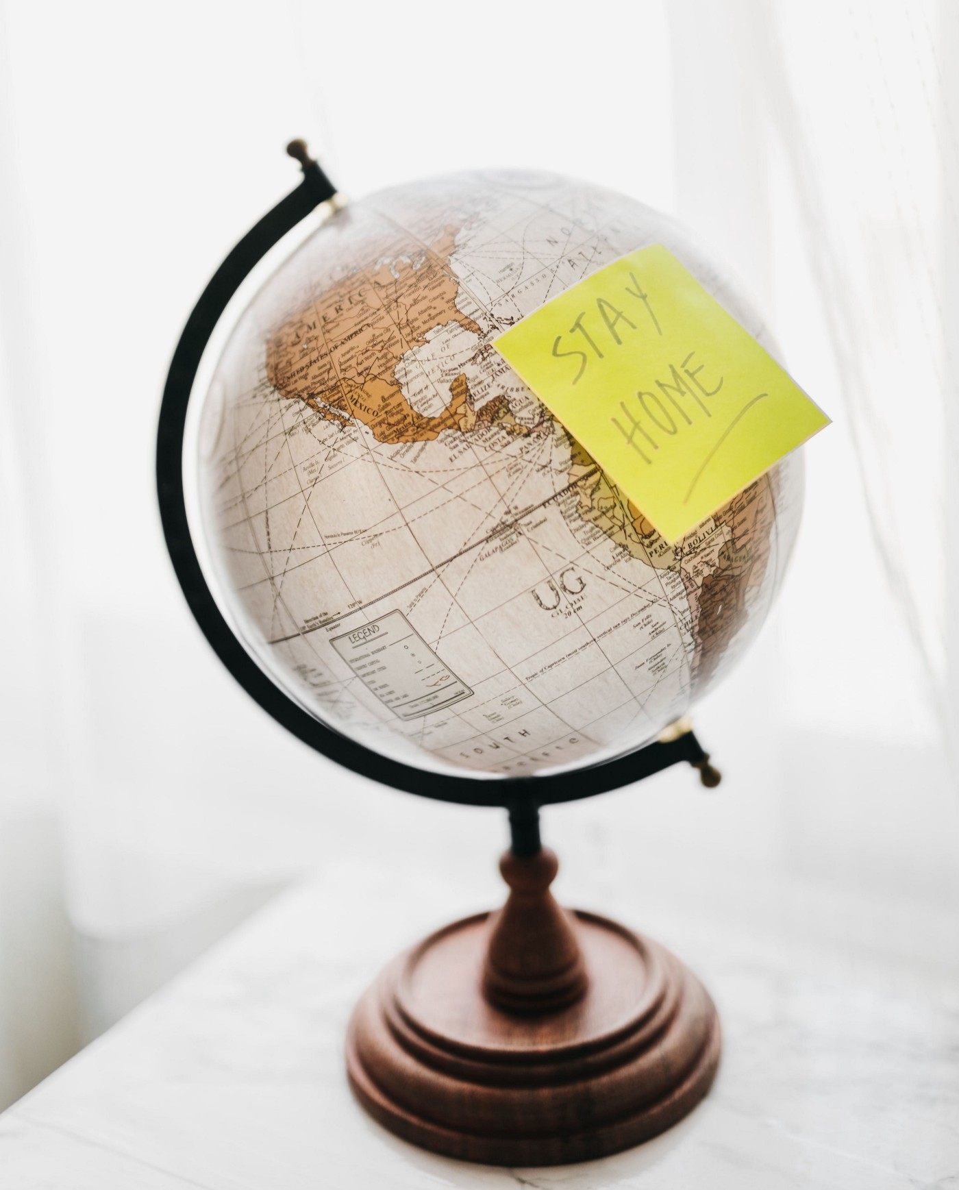 Globe with a stay home sticker