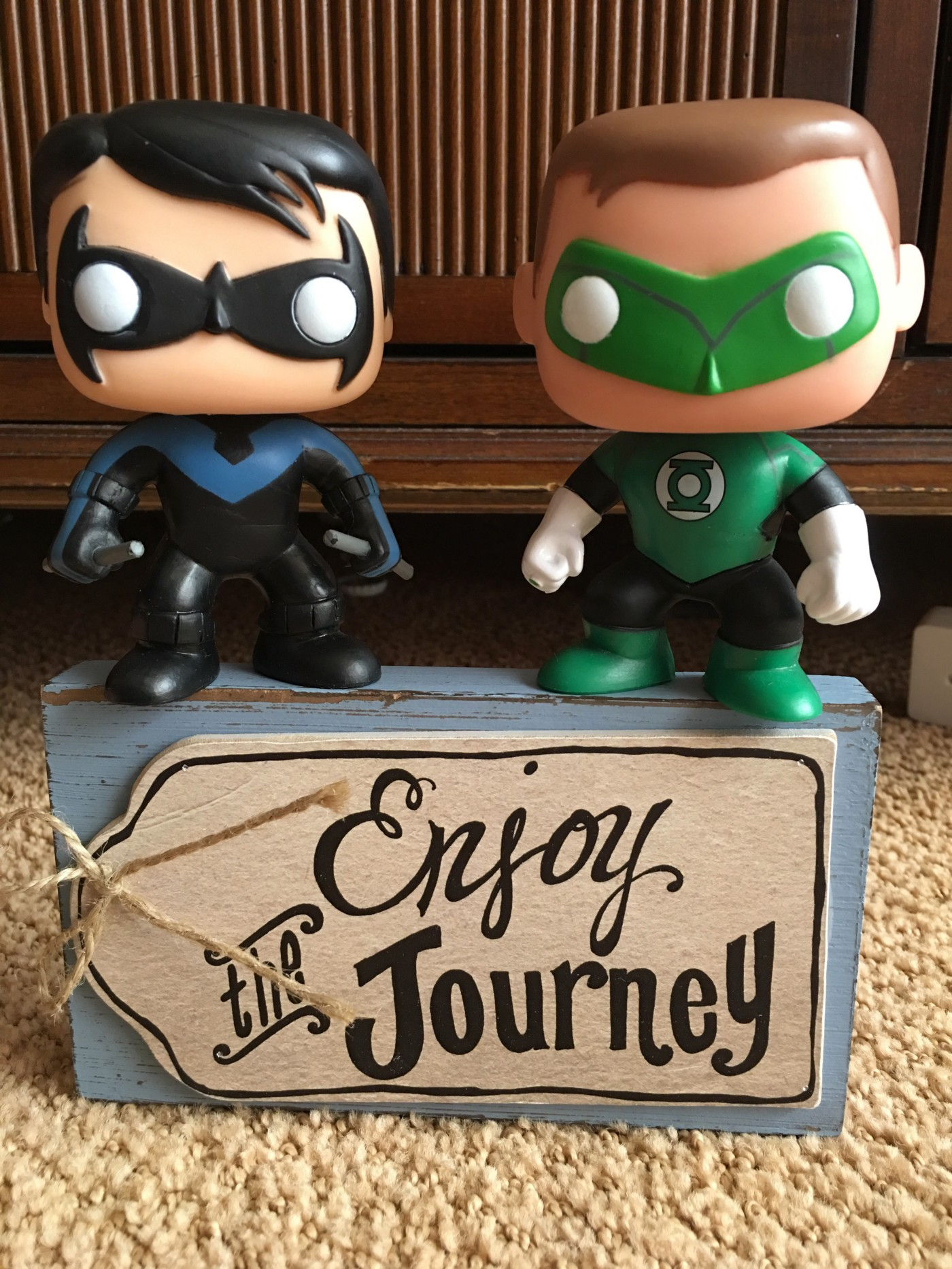 Funko figures of Nightwing and Green Lantern on Enjoy the Journey decoration.