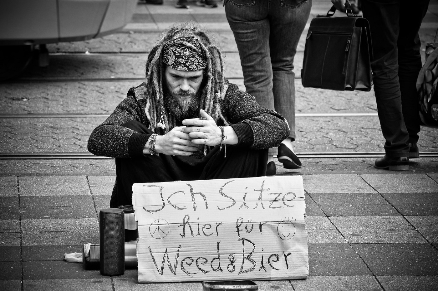 "Picture of a man with a sign that says: ""I Need Money for Weed and Beer"""