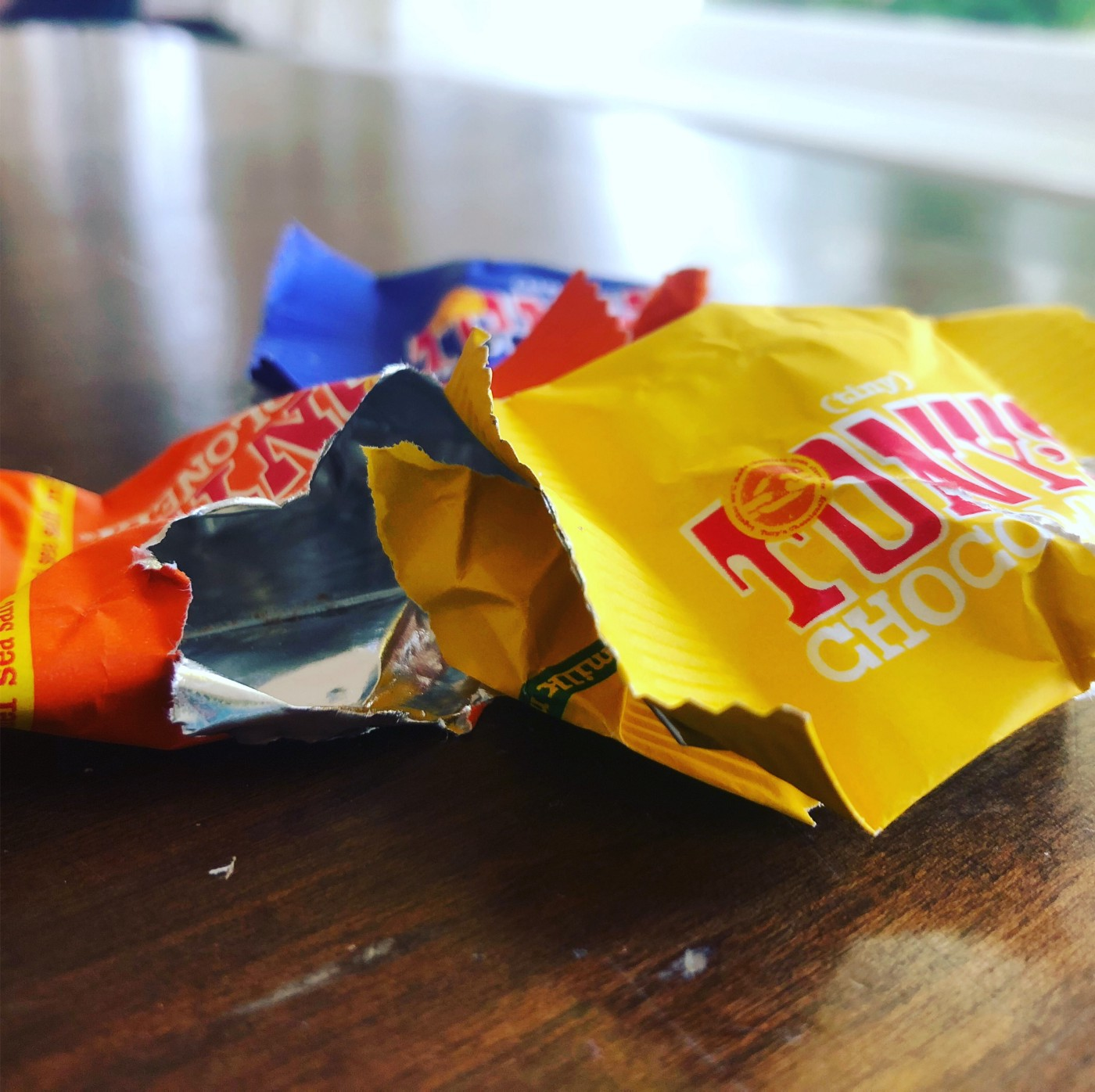 a picture of some empty Tony's chocoloney wrappers after a long day with many meetings