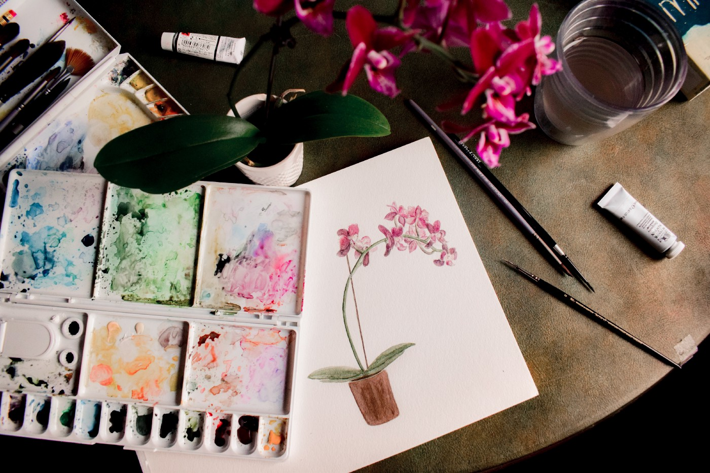 Tabletop of art supplies. Creating art for mental wellness and joy.