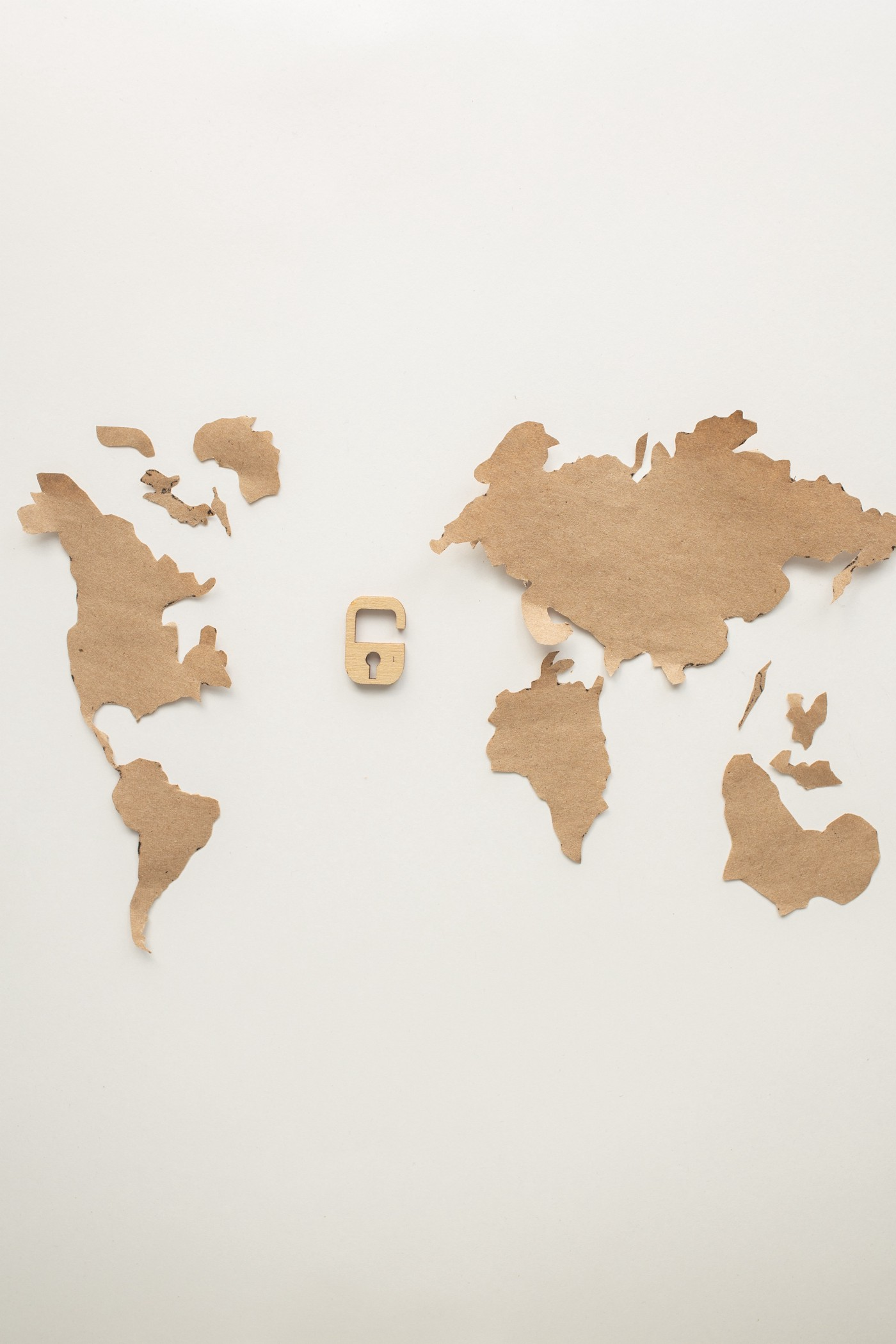 cardboard cut outs of the continents and an open lock