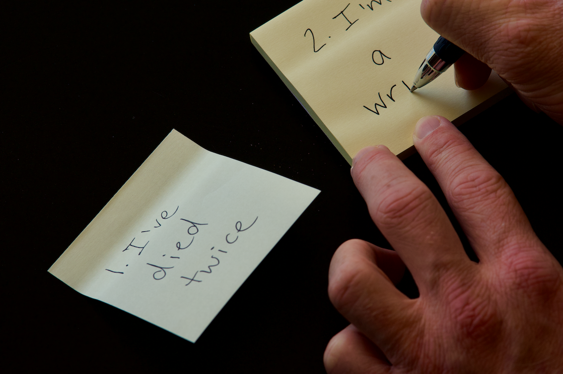writing on post-it notes, 1. I've died twice, 2. I'm a wri…