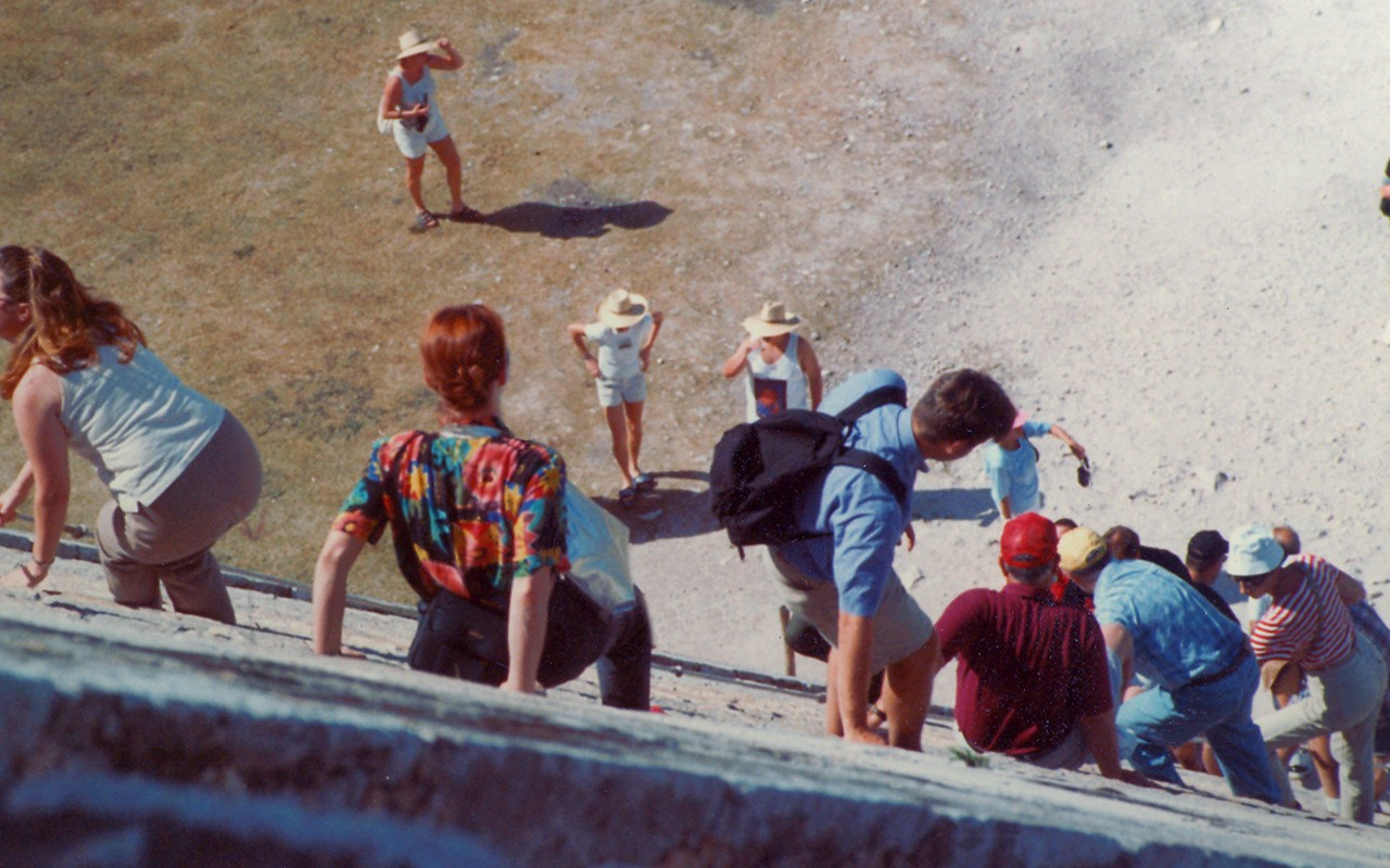 Author (Red hair) descends pyramid at Chichen Itza