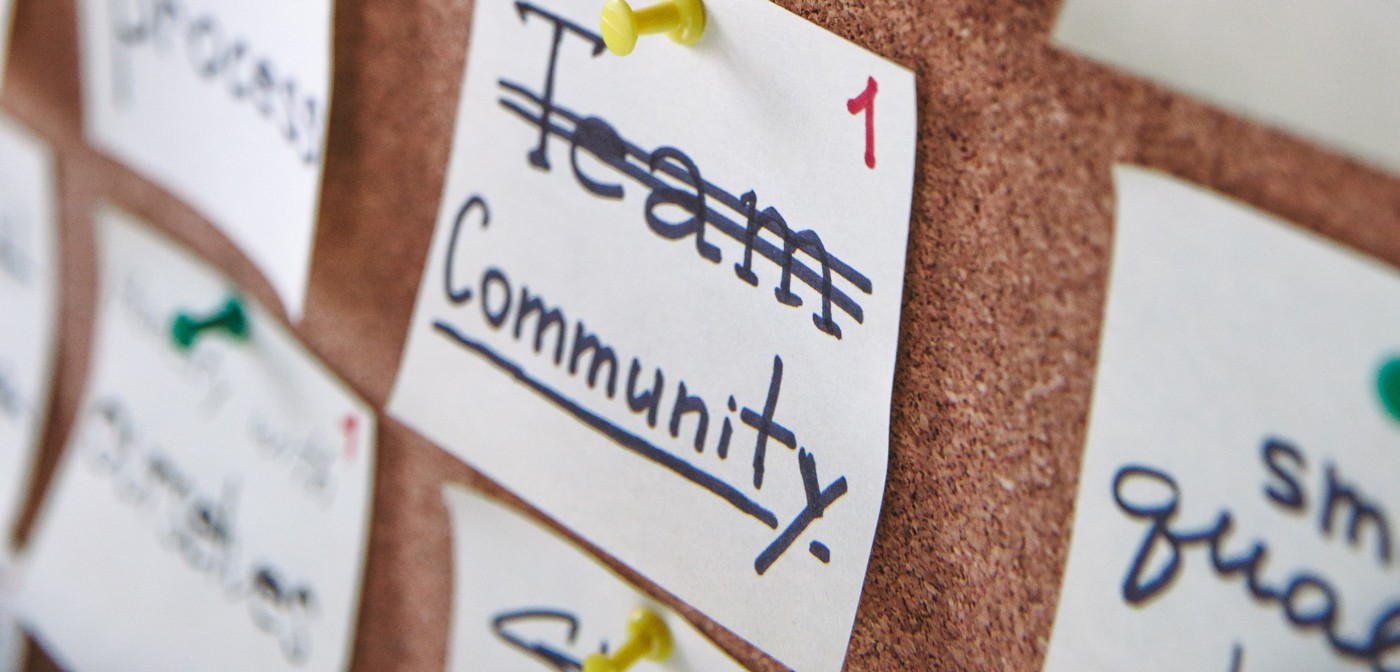 "note cards pinned to cork board with ""community"" written on it"