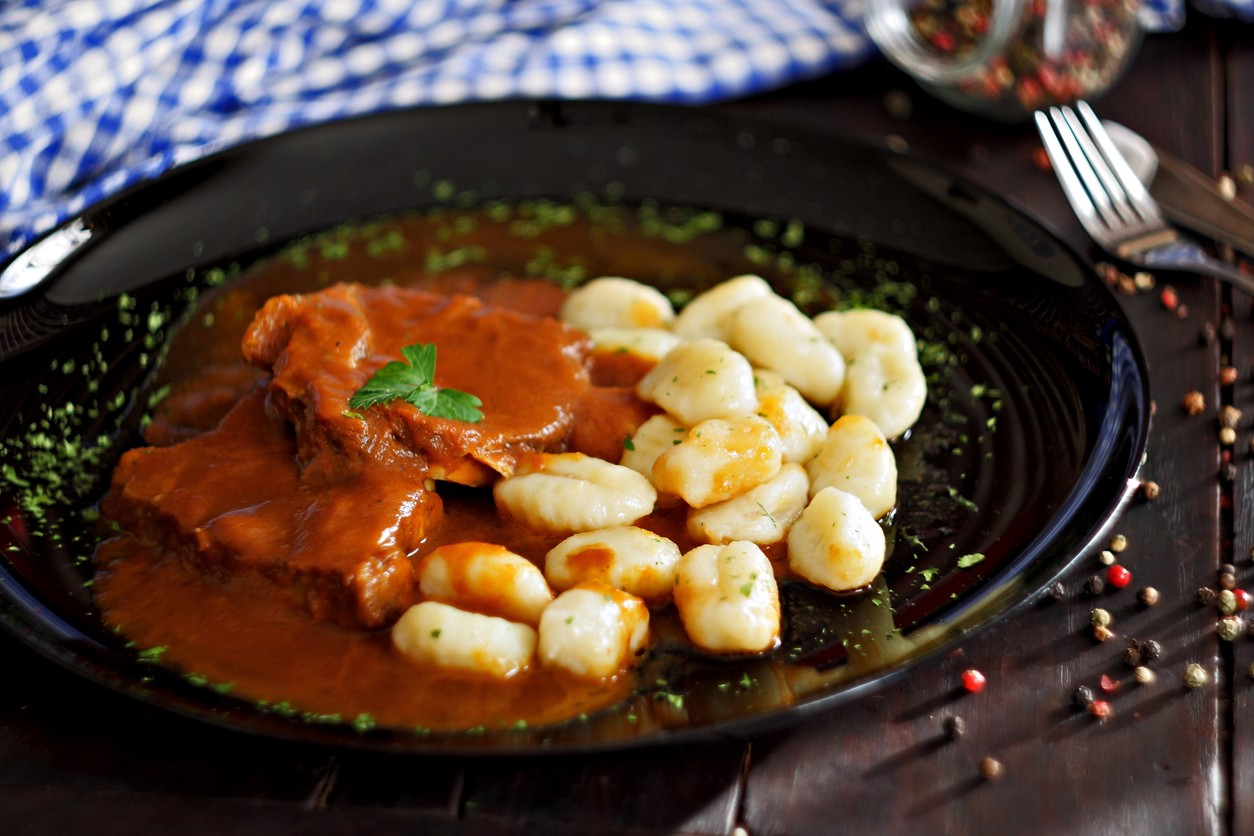 Pasticada with gnocchi, beef stew in a sauce. Croatian cuisine.