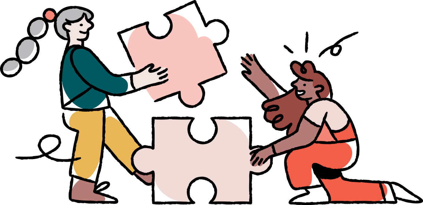 Two people working together to assemble puzzle pieces