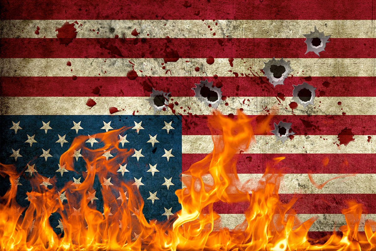 American Flag in distress, with flames, bullet holes and blood splatter.