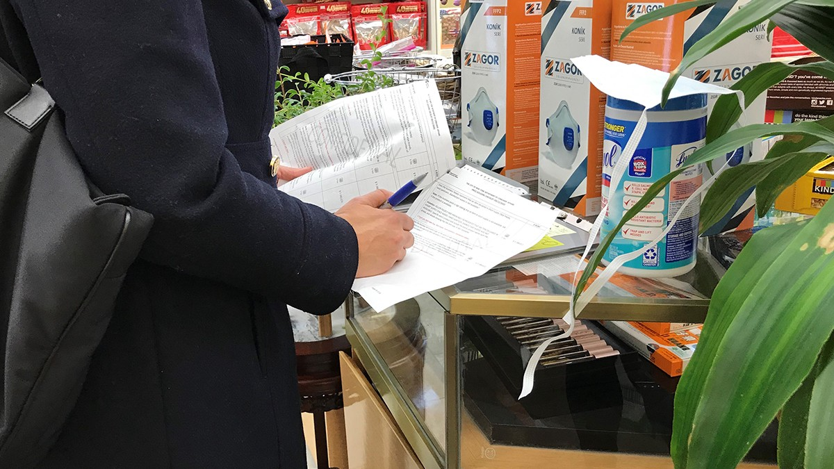 DCWP Inspector writes a violation for price gouging at a store that sells face masks and cleaning wipes.