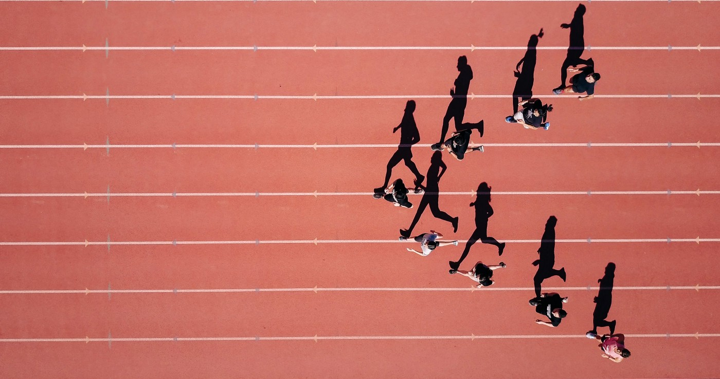 An top down image of people running on a race track
