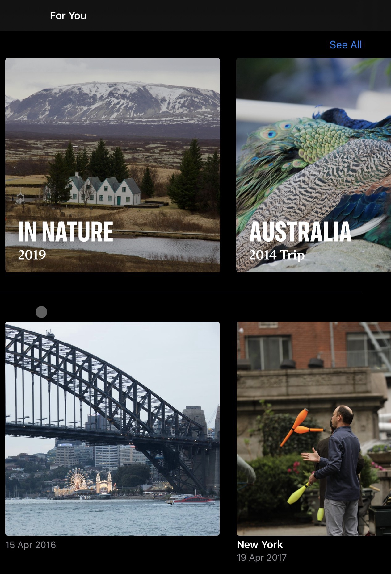 Four albums of Iceland, Australia and New York created by Apple Photos