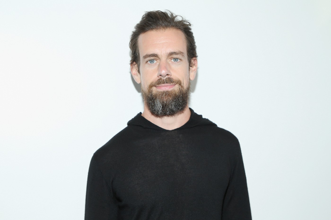 A close up of Twitter's CEO, Jack Dorsey against a white background.