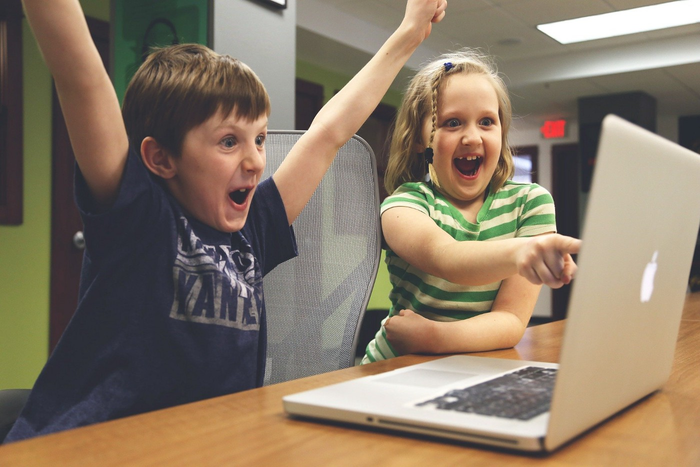 Children happy at looking at a screen