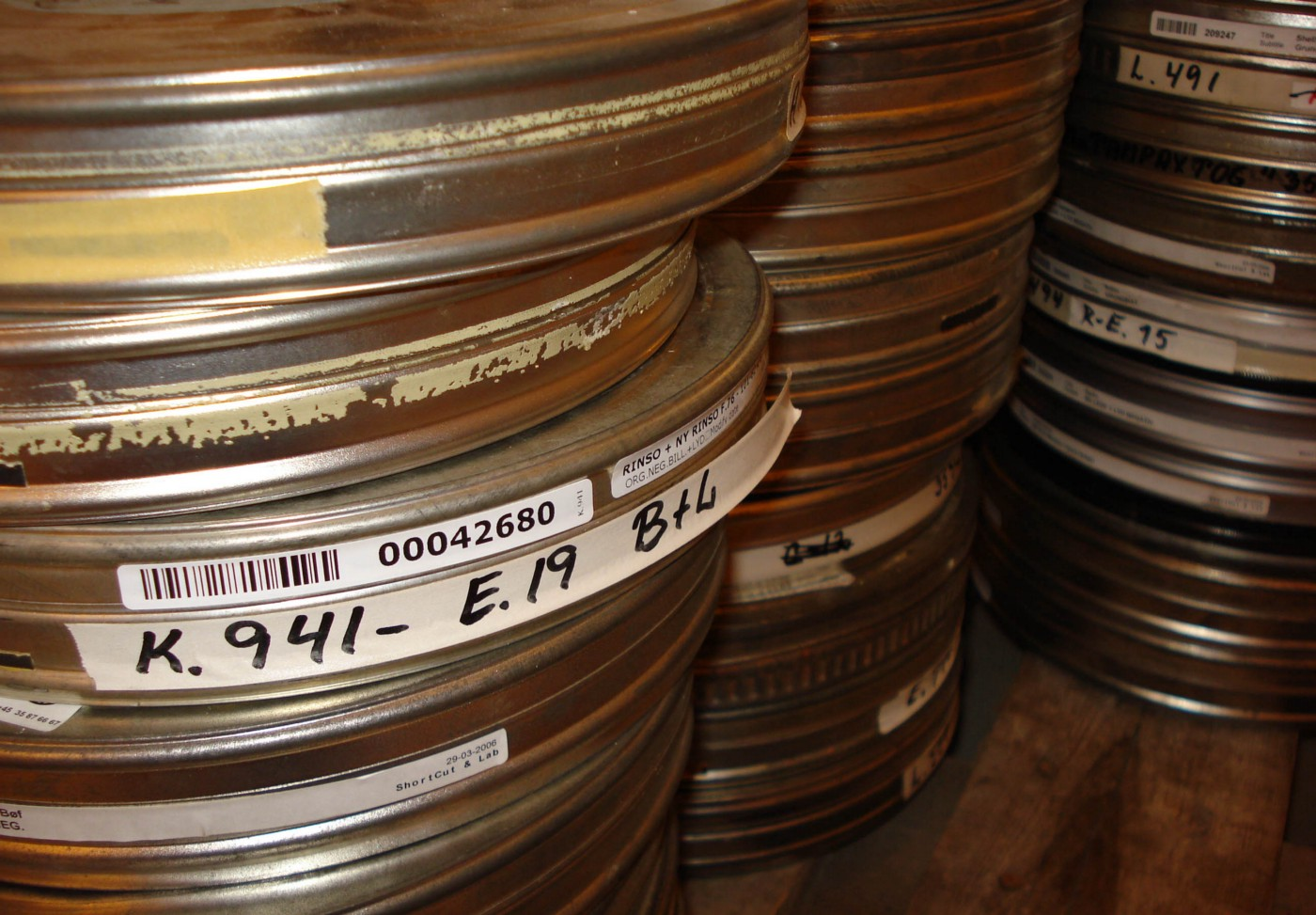 Several piles of round tin boxes containing films.