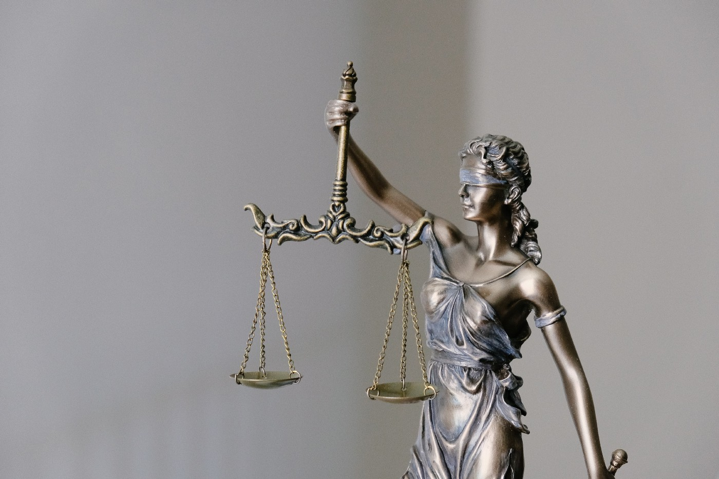 sculpture of Lady Justice blindfolded and holding balance scales