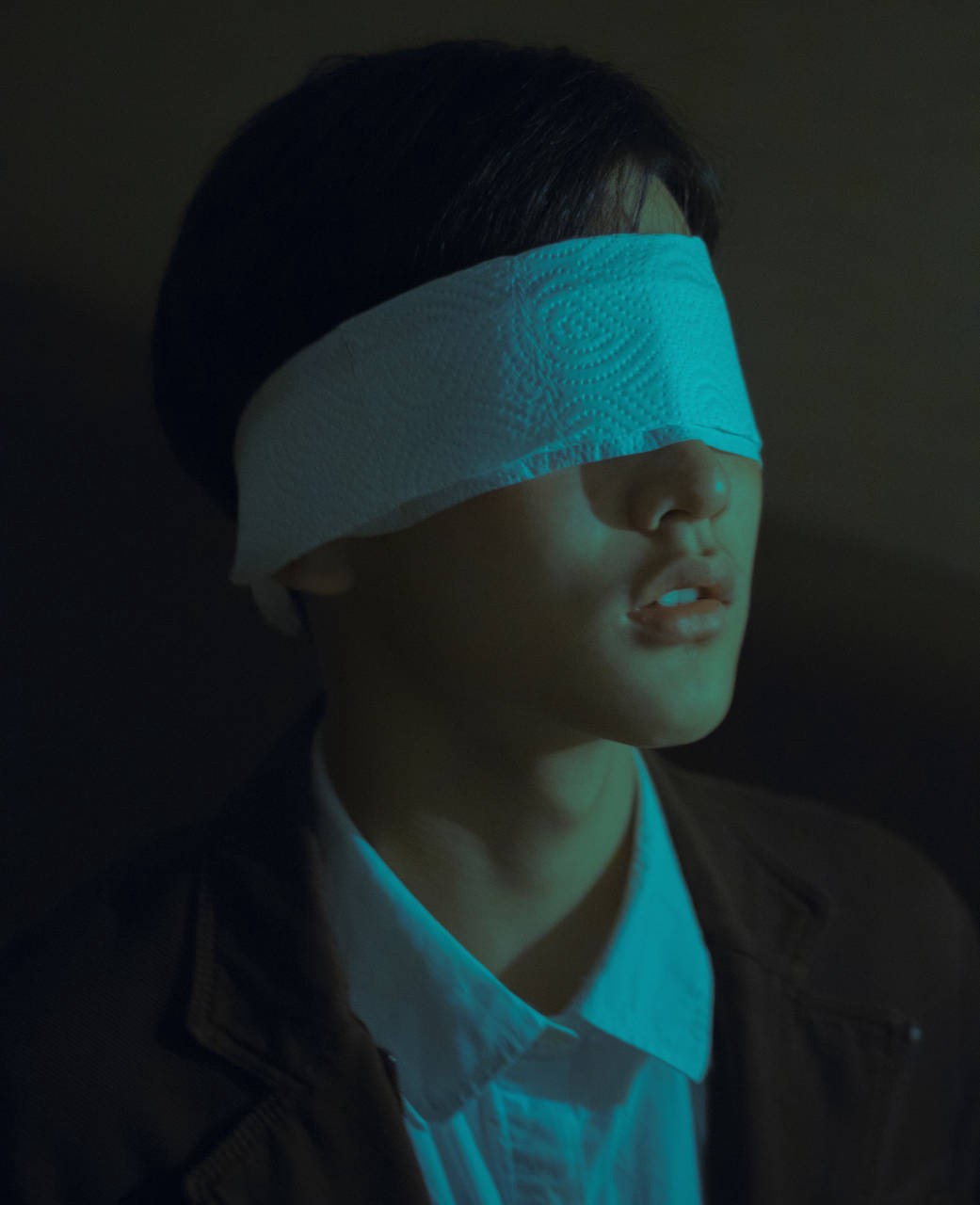 Person with eyes covered