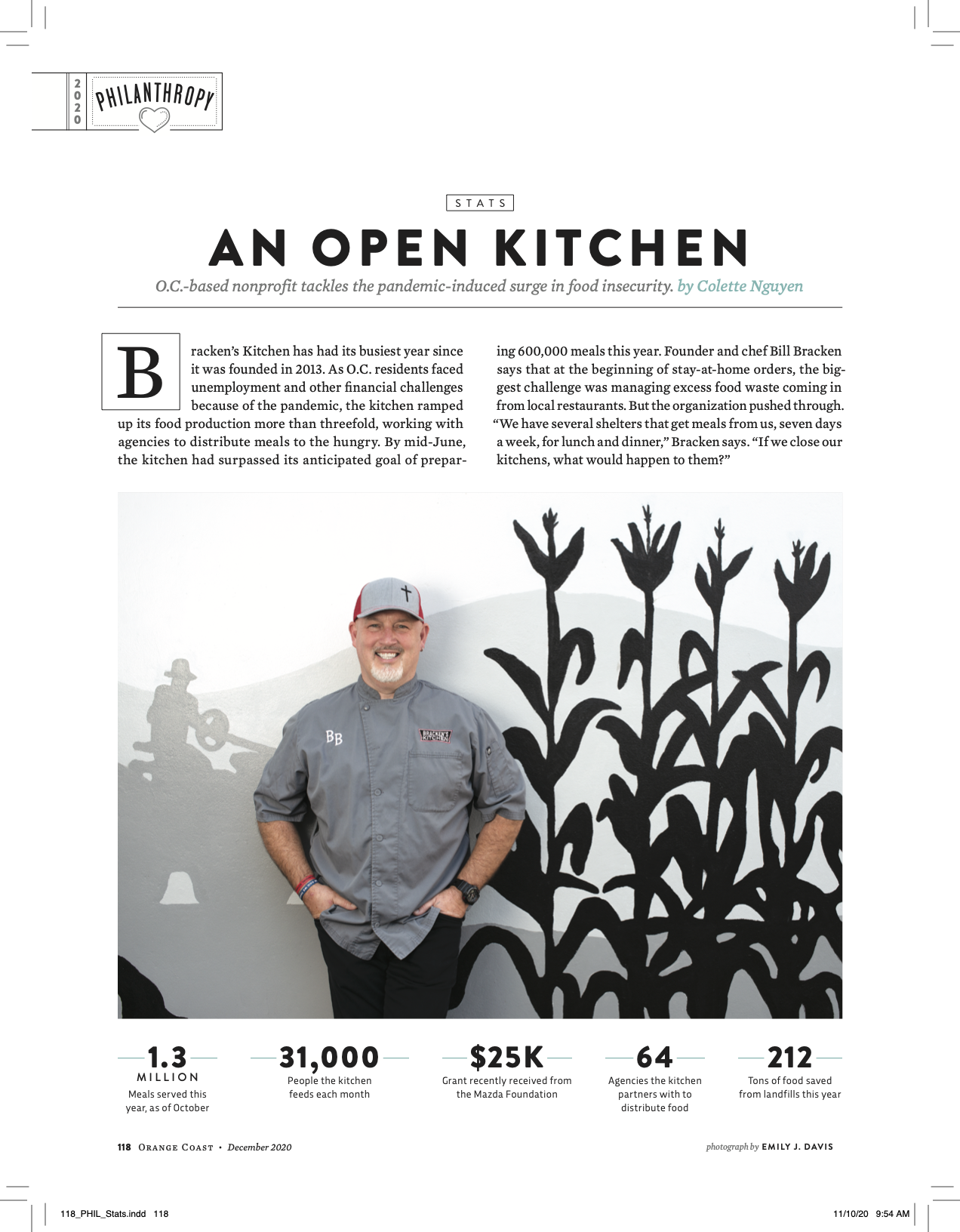 """A page from a magazine of a story called """"An Open Kitchen"""" featuring a man standing in front of a mural of a cornfield smiling"""