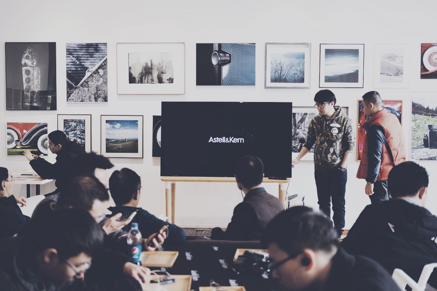 A duo gives a presentation to a crowd