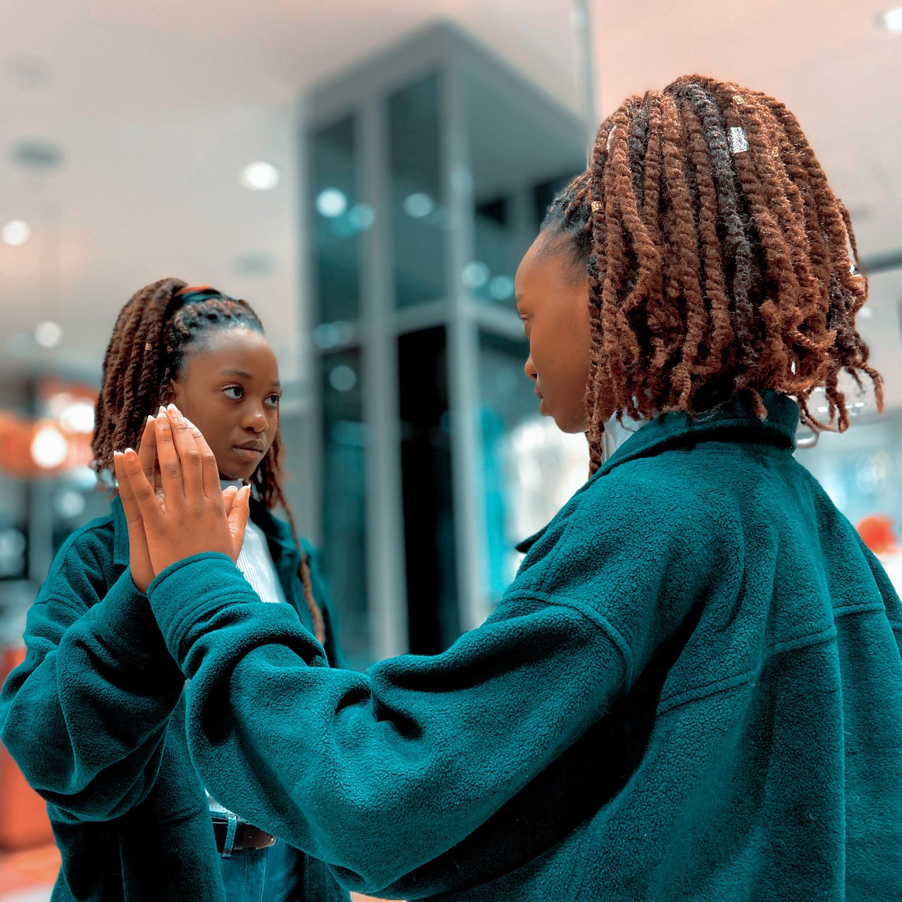 Woman looking at herself in a mirror.