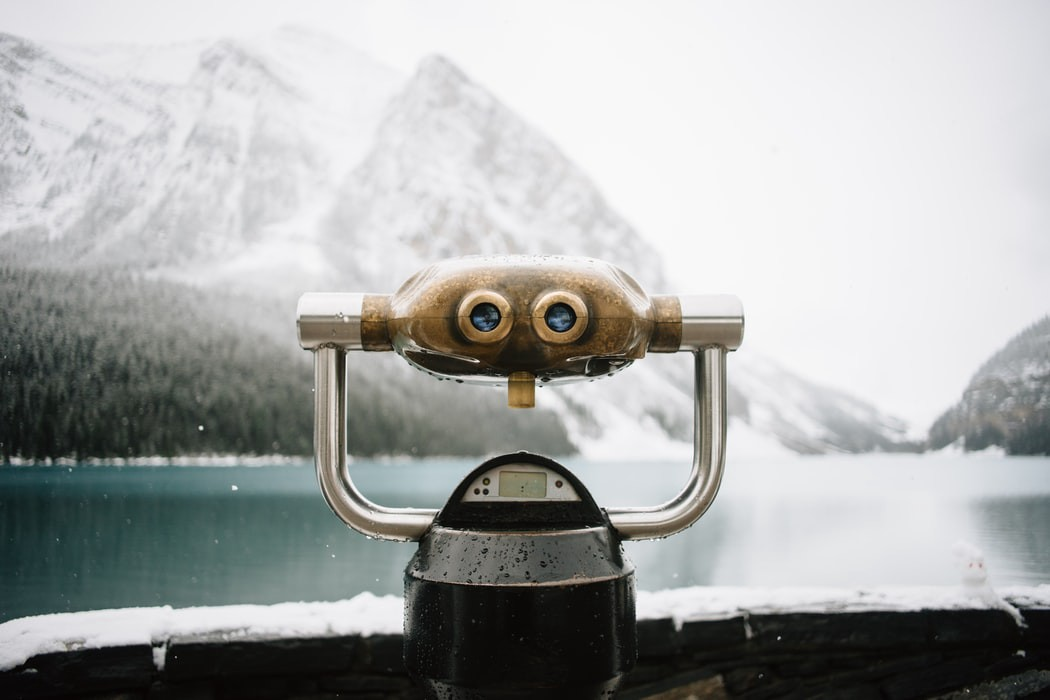 Binoculars facing a lake
