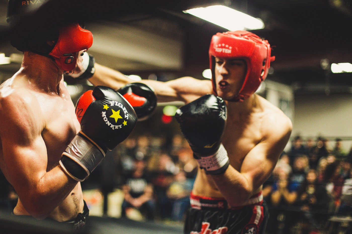 Two boxers in a boxing ring.