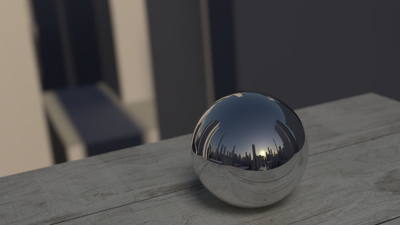 A reflective ball on a ledge reflects the city around it