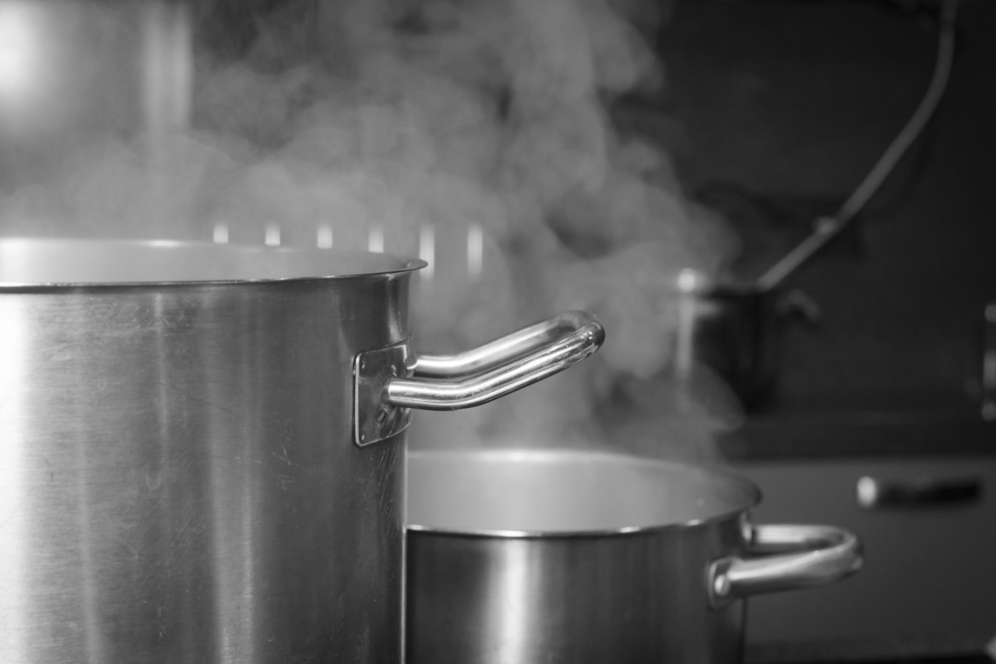 Steaming pots in a black and white.