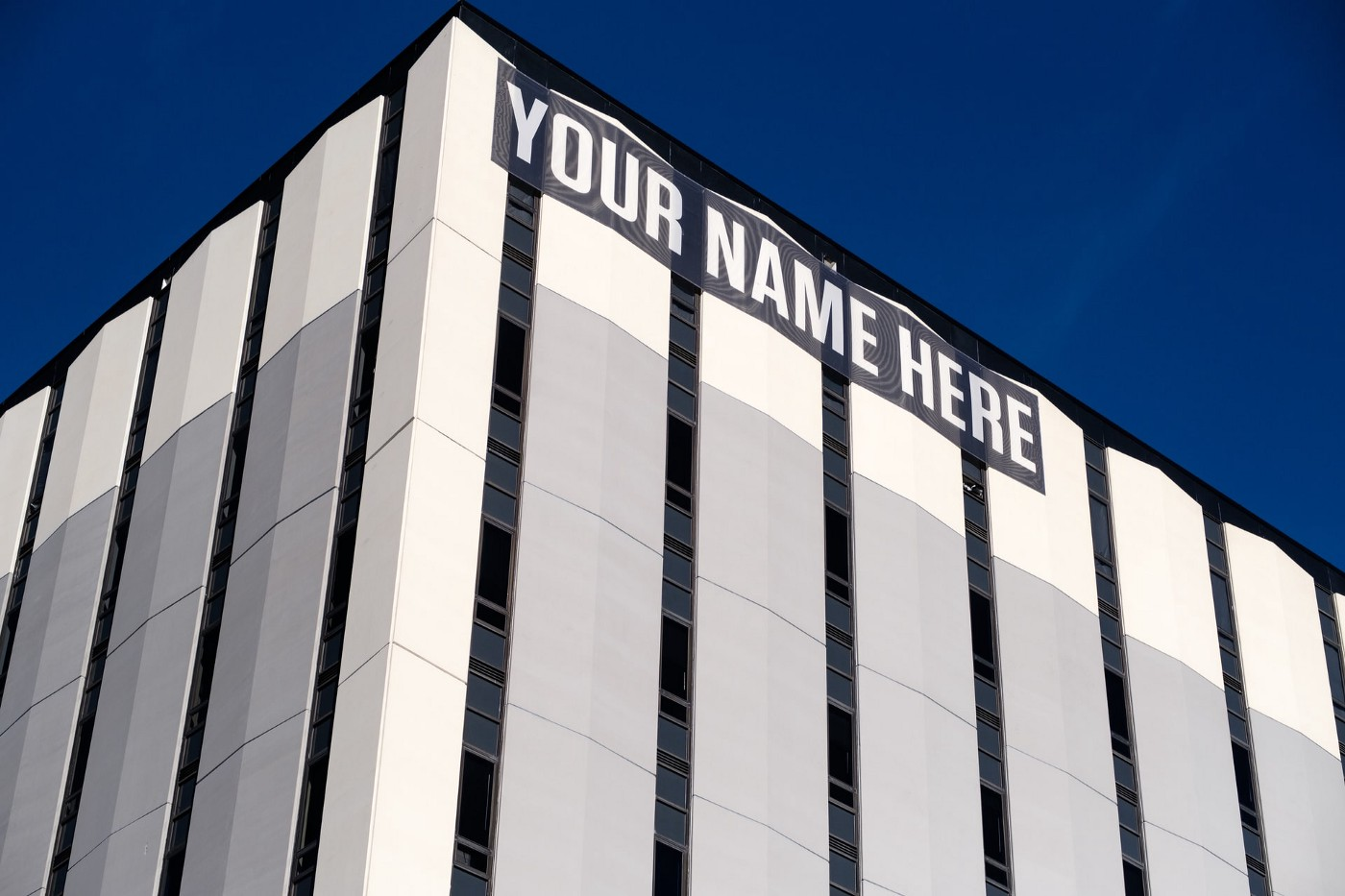 """A building with """"your name here"""" in the space where a company name should be."""