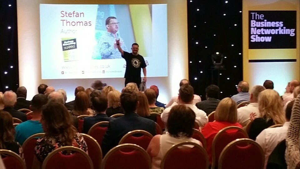 The author, Stefan Thomas, speaking in front of an audience at an event called The Business Networking Show