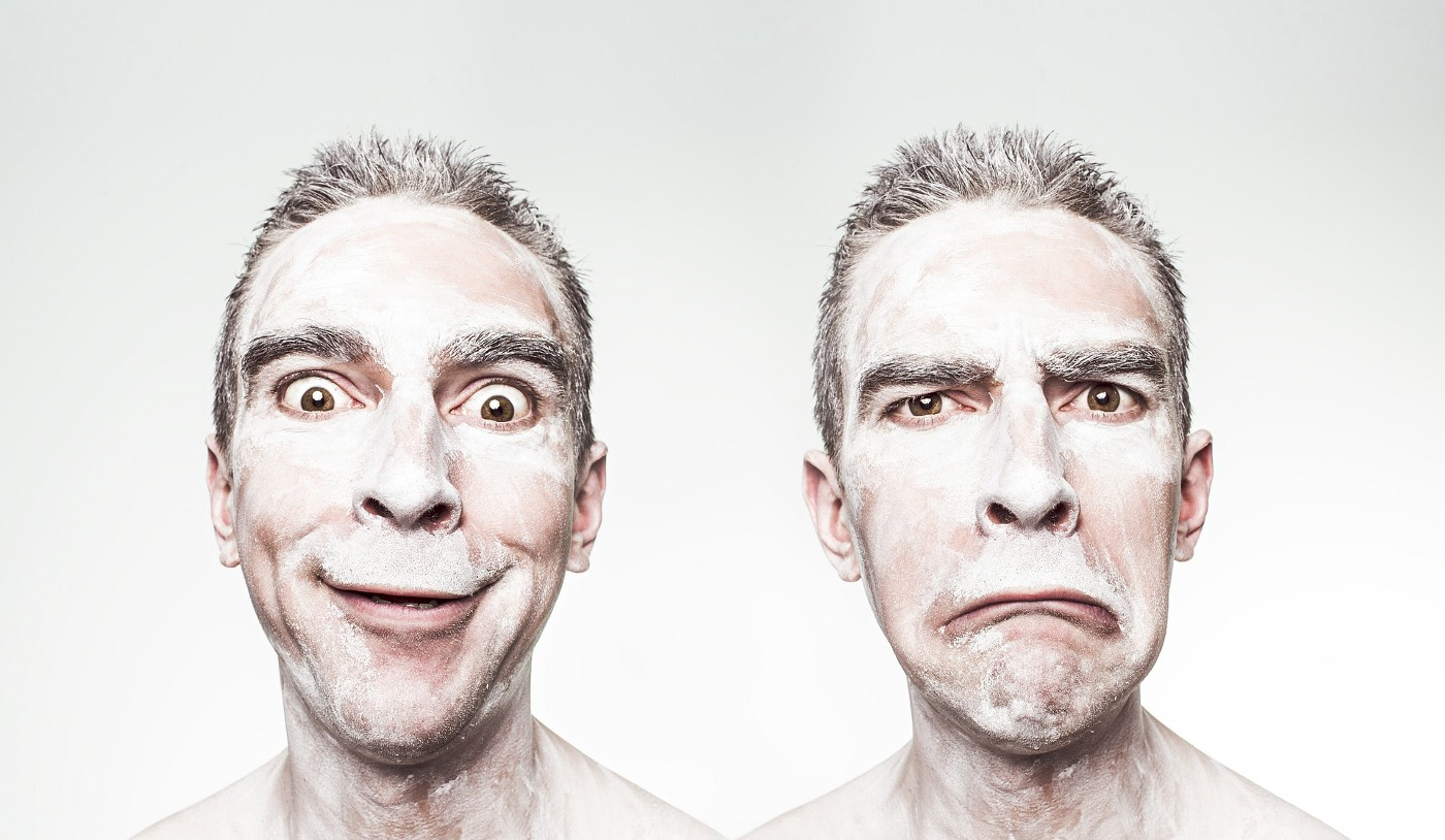 Man pulling two different faces
