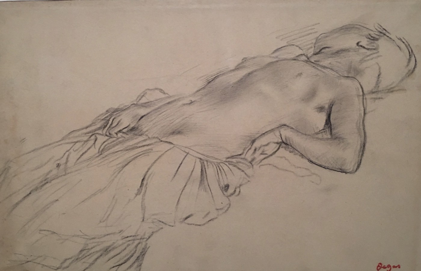Sketch in charcoal of a reclining woman naked above mons pubis. Turning her head away, her right arm follows curvaceously below hip, left arm is bent, outer hand filling her waist, resting on hip.