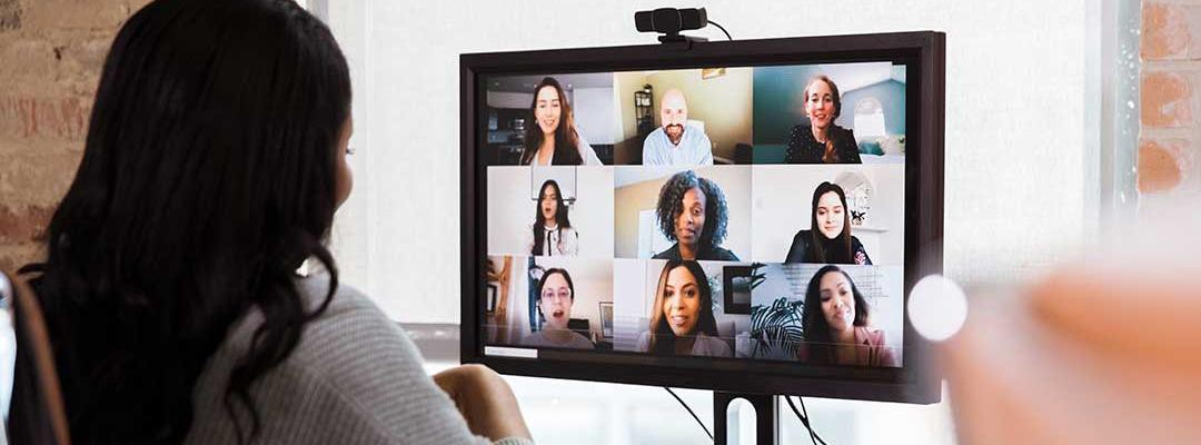 Black professional woman on teleconference call with colleagues