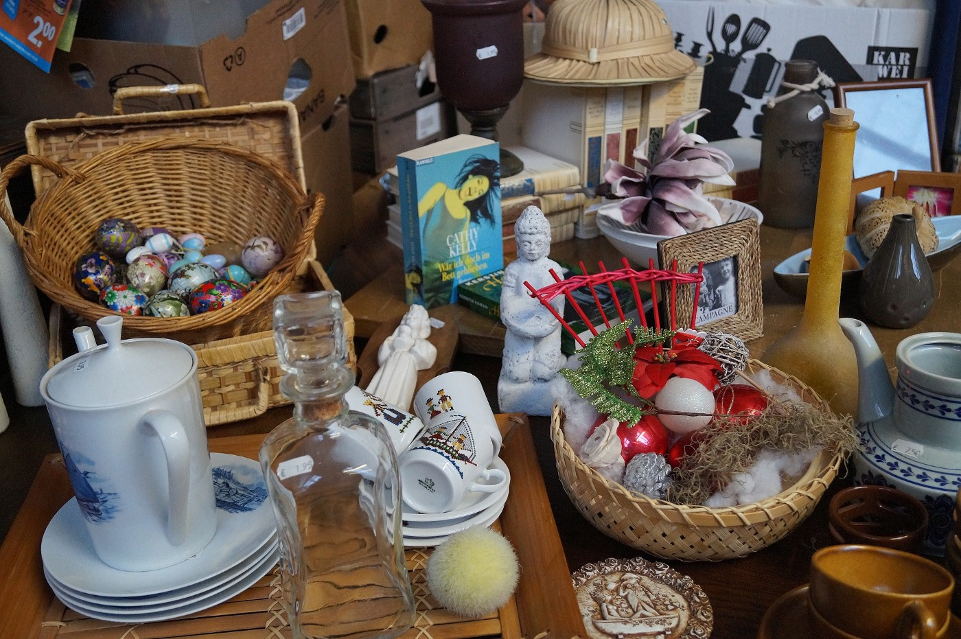 A display of mini cups and saucers, painted eggs and bric-a-brac.