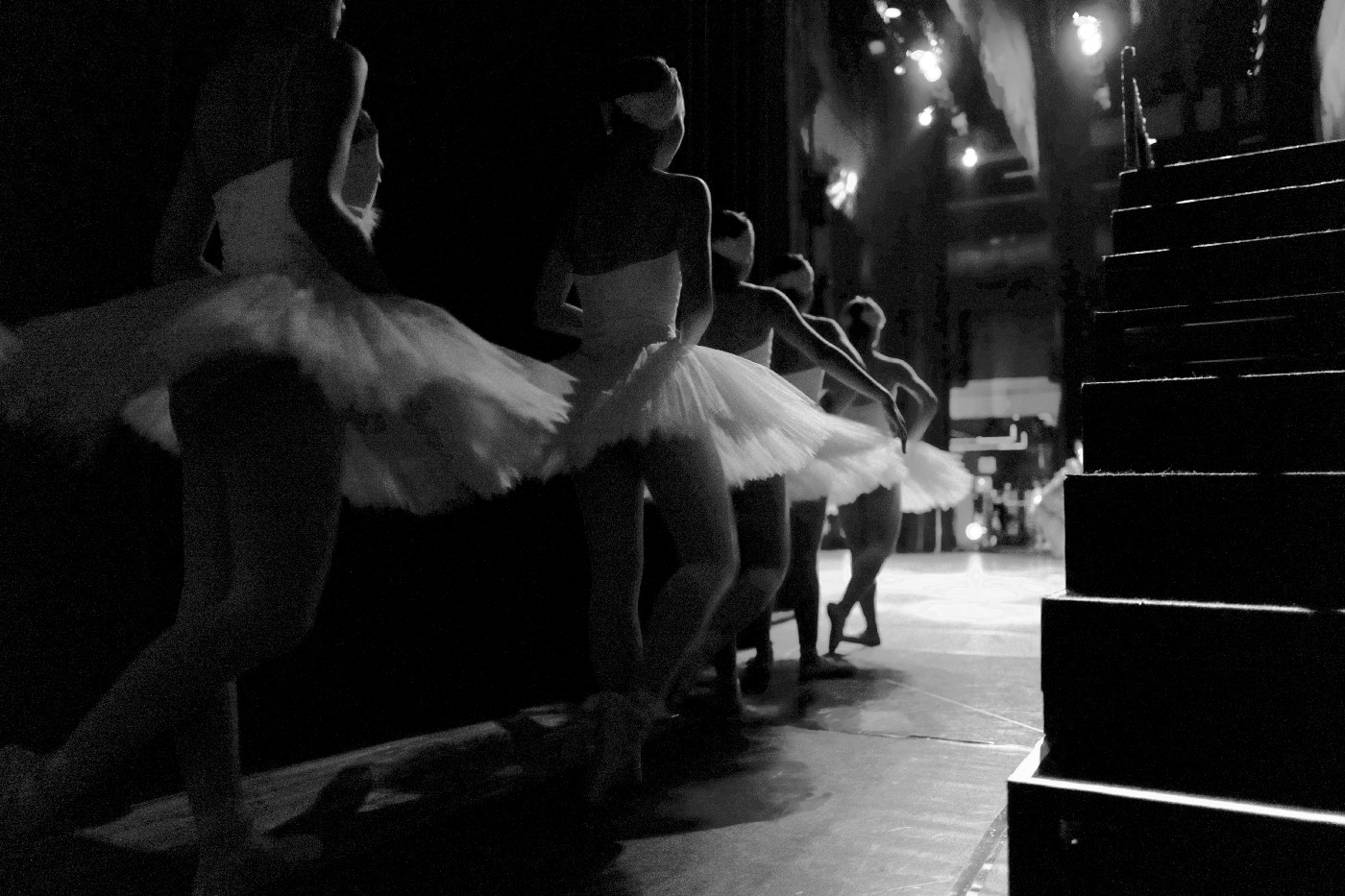 Ballerinas in tutus waiting off stage for their entrance