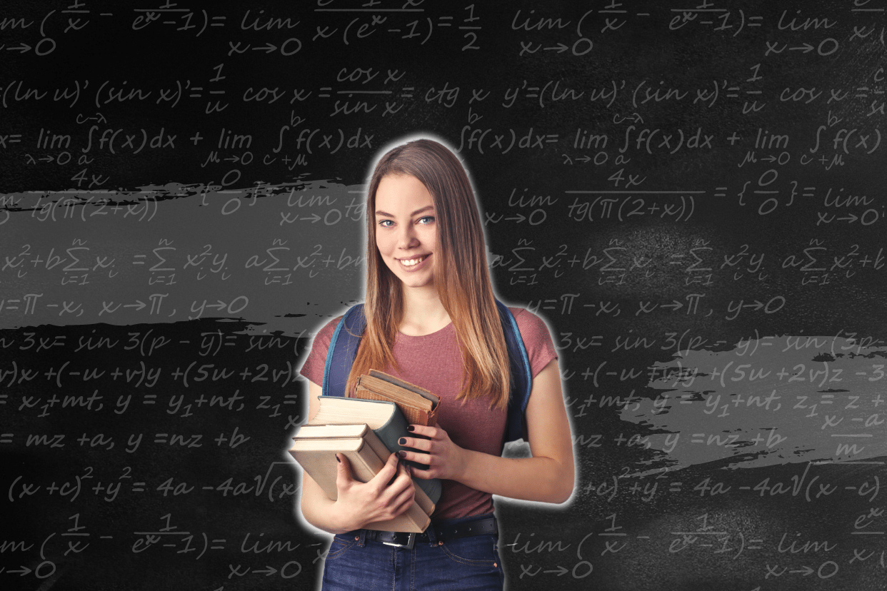 A picture of a young woman holding books in front of a black board.
