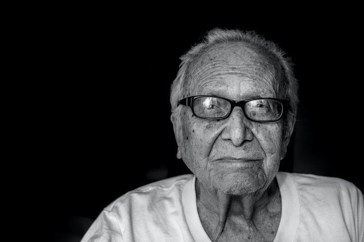 An image of an older man with glasses, looking into the camera.