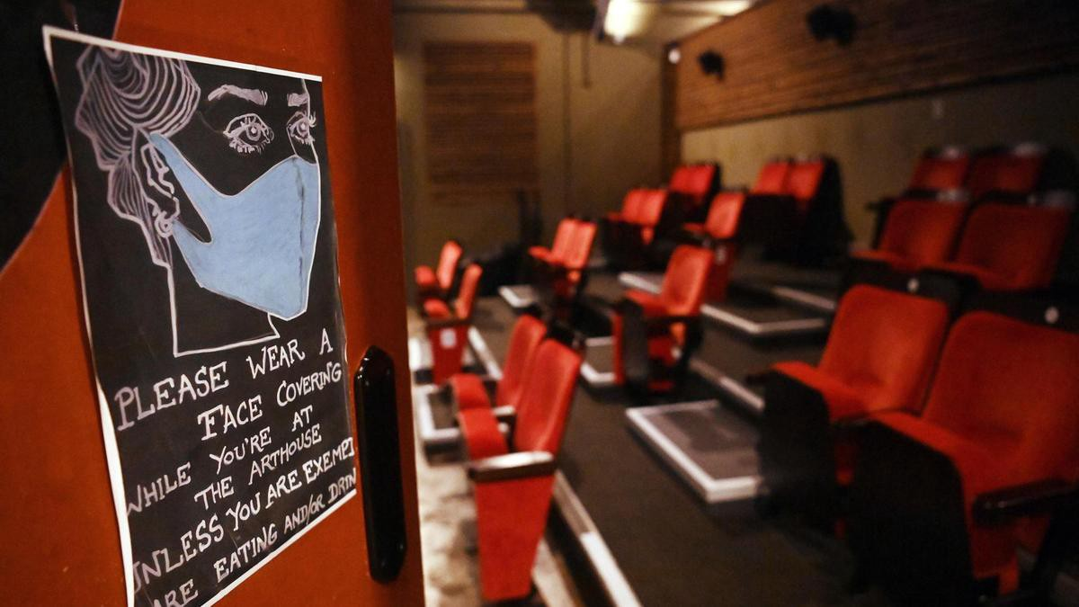 A sign reminding people to wear a face mask while in a small independent cinema.