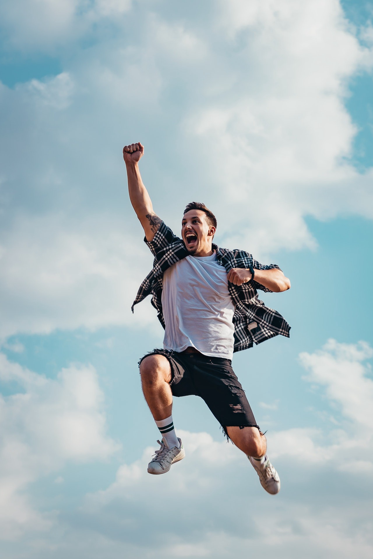 A happy man jumping in the air