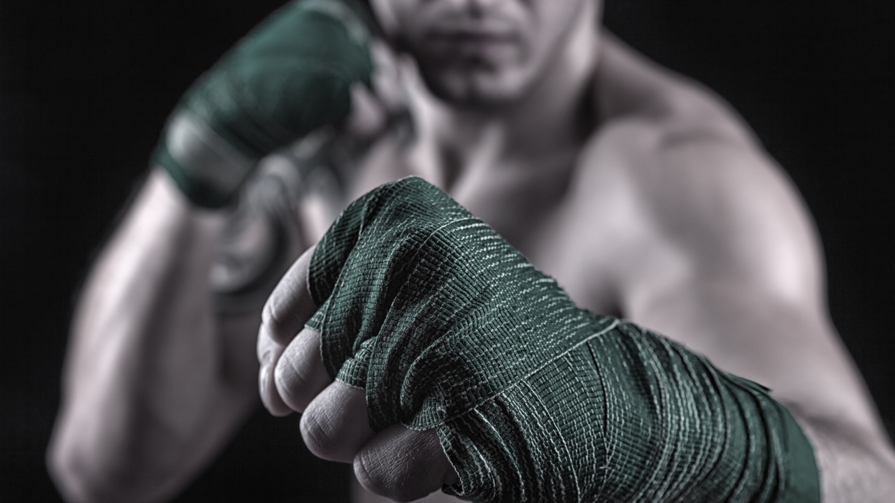 A man in a boxing stance, fists up and bandaged. Image for 5 Ingenious Ways To Fix Your Fight Scene