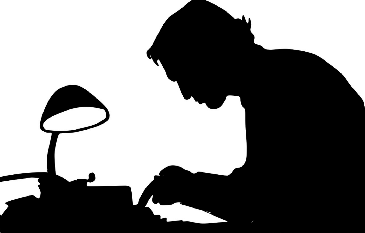 black and white silhouette of man at typewriter