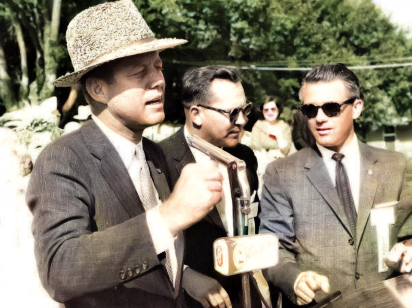 Sen. John F. Kennedy campaigns for President in Crowley. Congressman Edwin W. Washington is on the right. Photo source: Raymond Reggie Family Collection; Colorized by Lamar White, Jr, Bayou Brief.