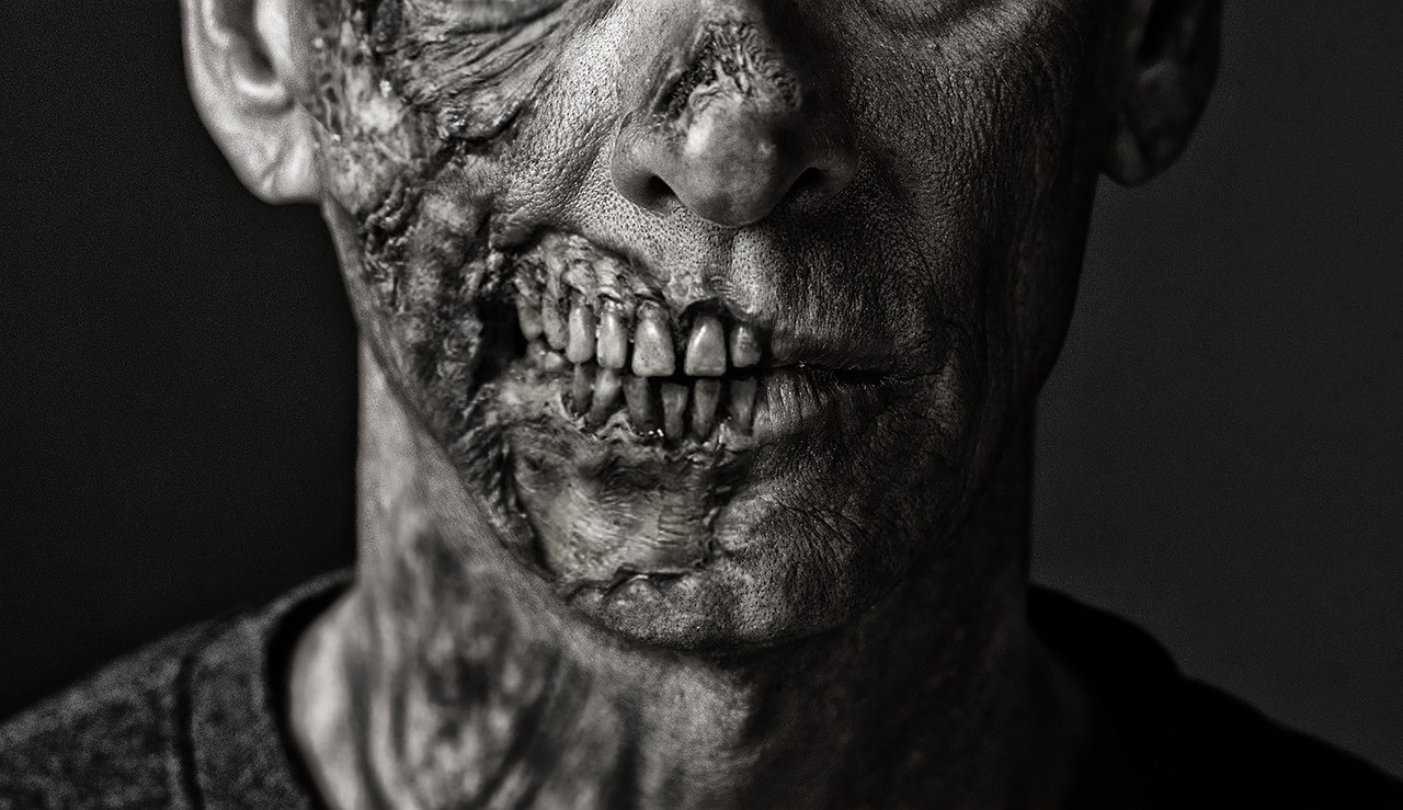 Close up of a rotting zombie face, teeth are exposed
